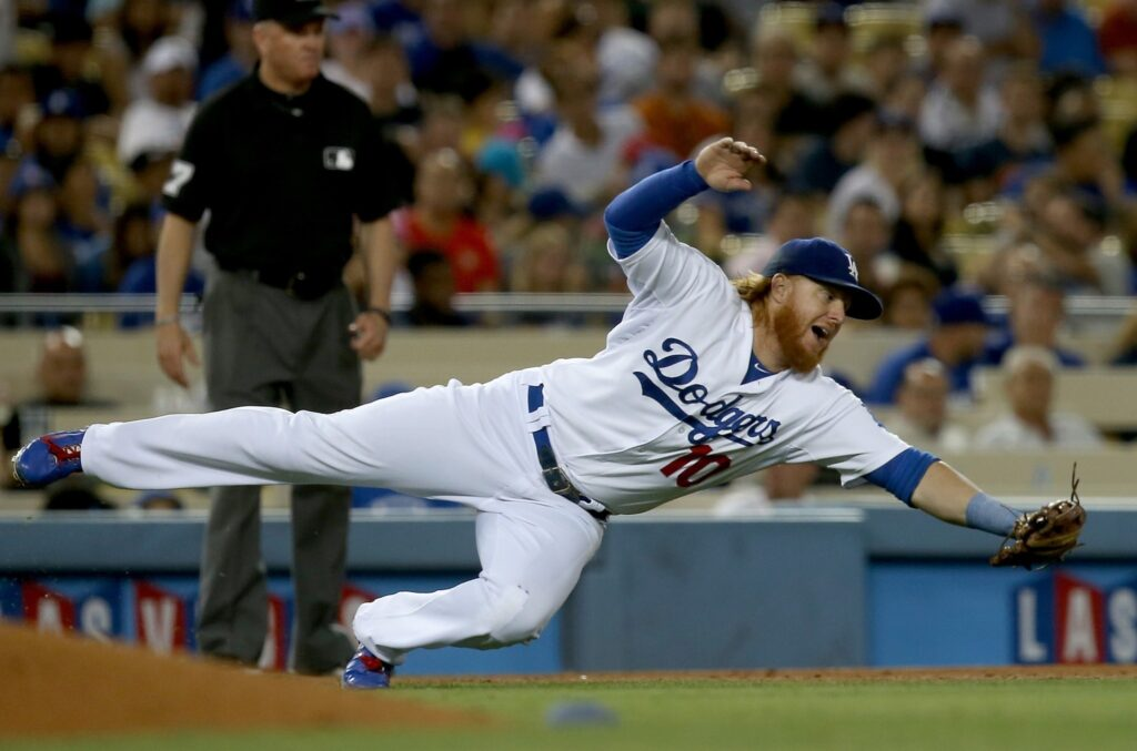LOS ANGELES, CALIF. -  AUG. 21, 2014. Dodgers third baseman Justin Turner dives for a ball hit shraply off the bat of Padres left fielder Abraham Almonte in the seventh inning on Thursday, Aug. 21, 2014, at Dodger Stadium in Los Angeles.  (Luis Sinco/Los Angeles Times)