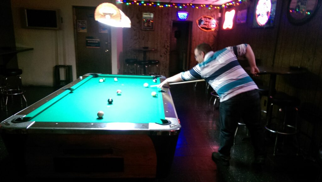 Jason shooting pool